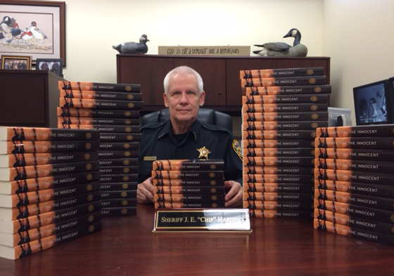 Albemarle County Sheriff J. E. Harding with copies of Convicting the Innocent